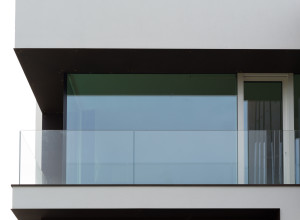 Glass balcony of modern house, close up view